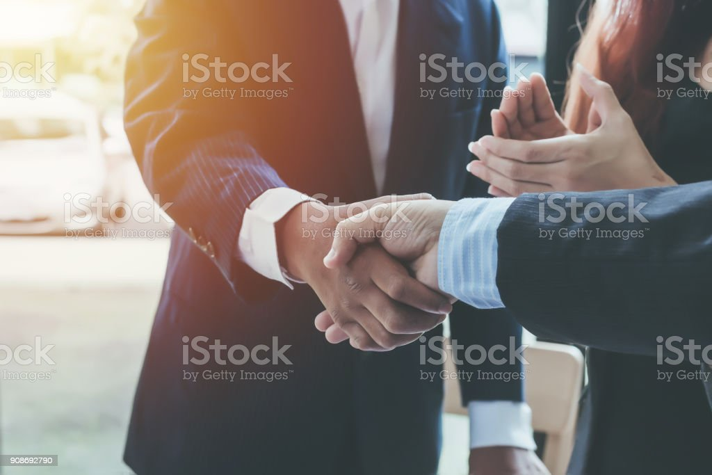 Business shaking hands. Business executives to congratulate the joint. stock photo