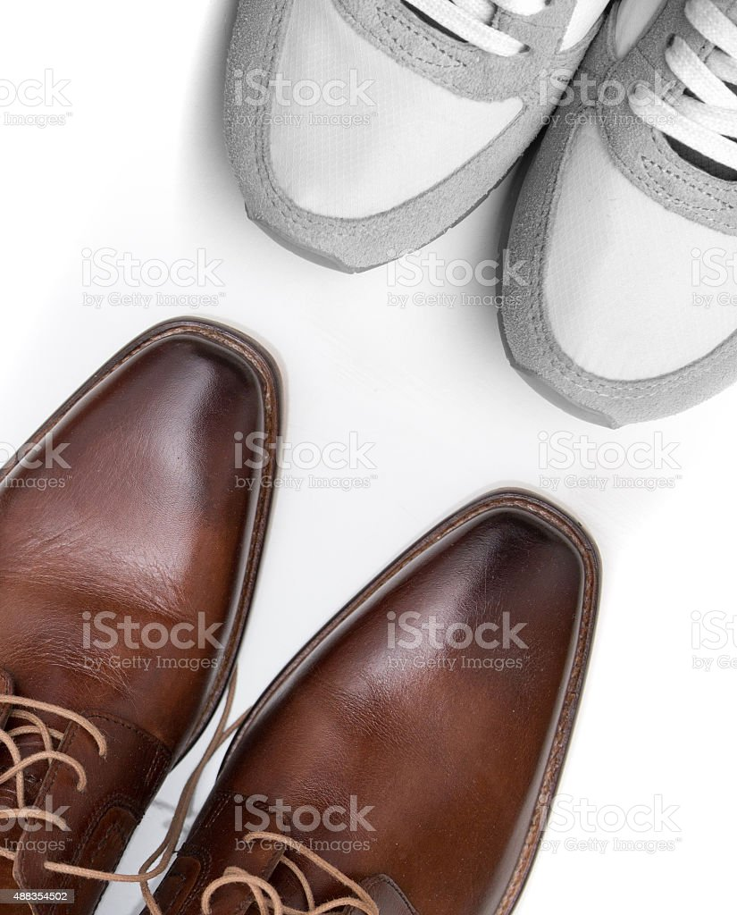 Business shoes and sneakers on white stock photo