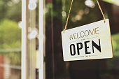"""istock A business sign that says """"u2018Open""""u2019 on cafe or restaurant hang on door at entrance. Vintage color tone style. 1298039173"""