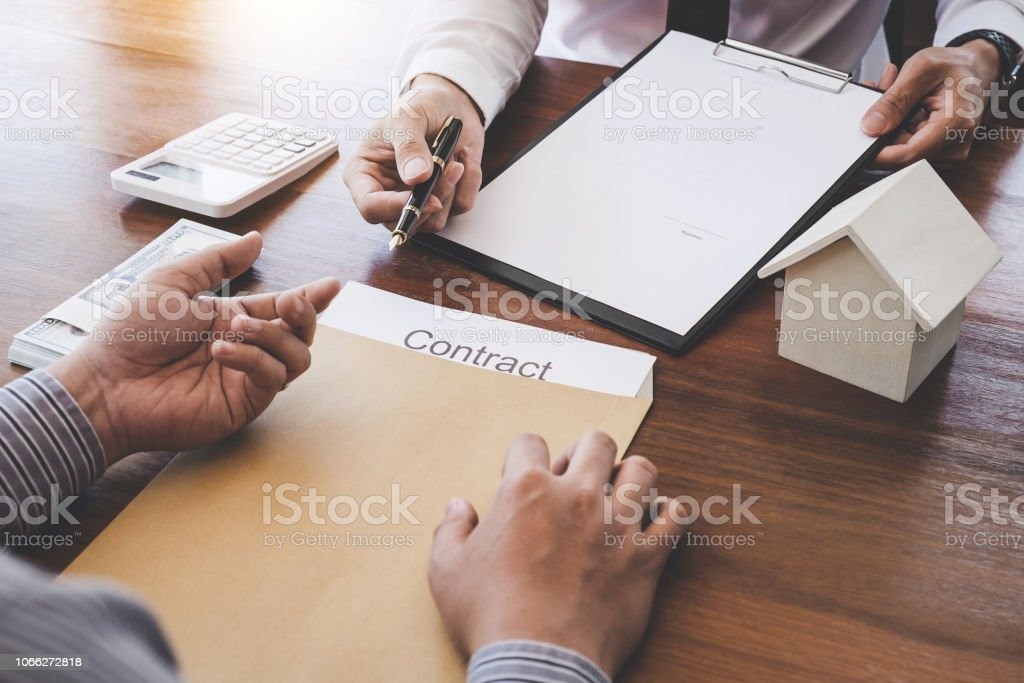 Business Signing a Contract Buy - sell house, Man sign a home...