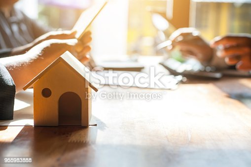 955988522istockphoto Business Signing a Contract Buy - sell house. 955983888