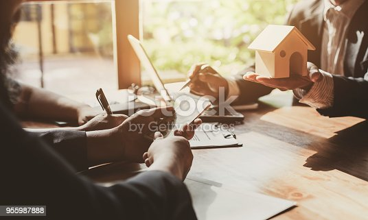 955988522istockphoto Business Signing a Contract Buy - sell house. 955987888