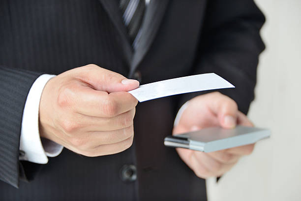 Royalty free exchanging business card pictures images and stock business situation exchanging business card stock photo colourmoves