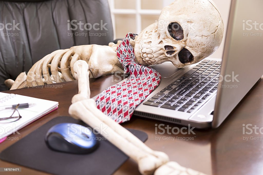 Business: Skeleton of man who worked himself to death. stock photo