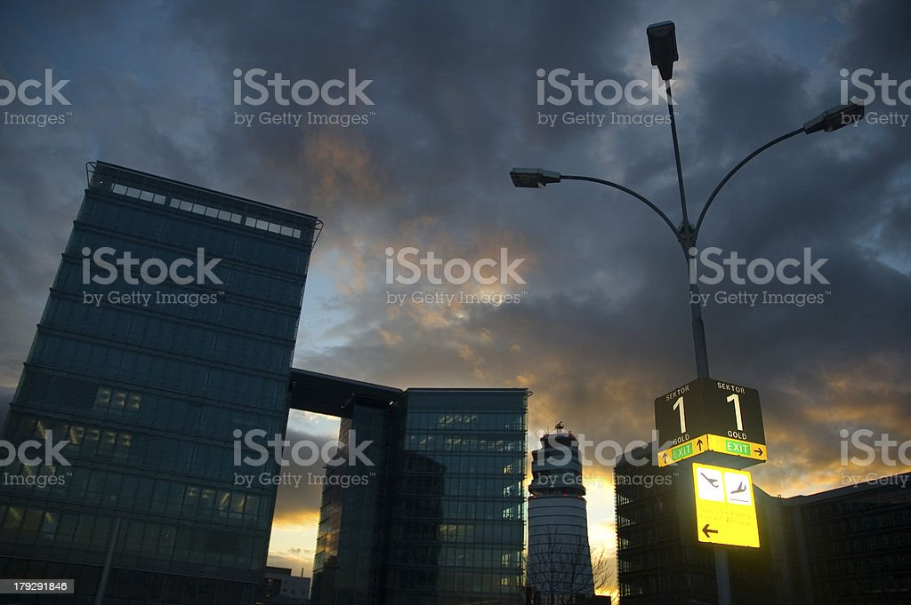Business skyscrapers with lamp in the sunset royalty-free stock photo