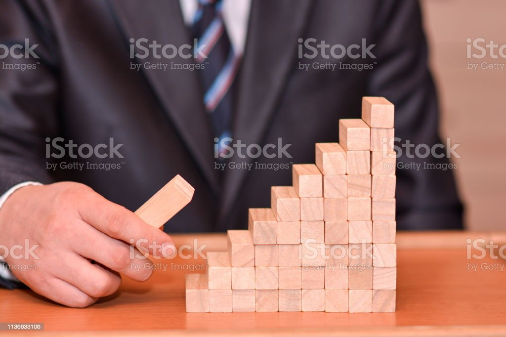 business smart man thinking of how to win the strategy game with...