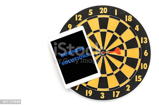 840201636 istock photo business solution on tablet screen with dartboard 541121848