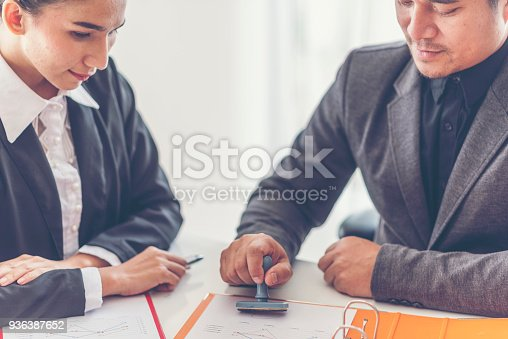 istock Business stamping rubber Stamp on a documents - business concept 936387652