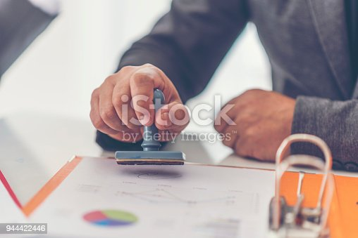 istock Business stamping rubber Stamp on a documents - business concept 944422446
