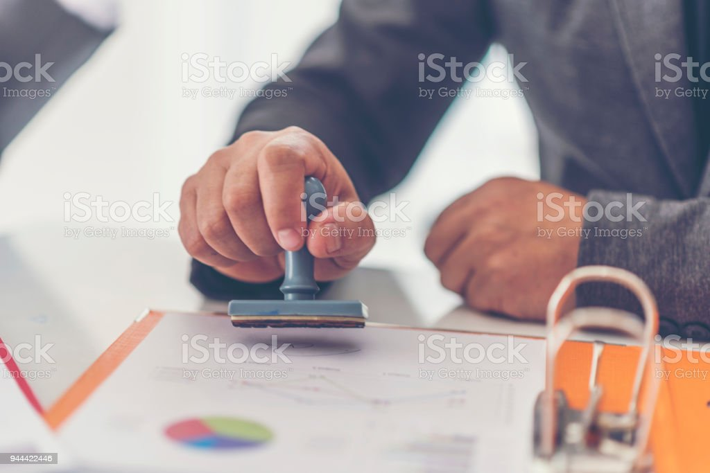 Business stamping rubber Stamp on a documents - business concept stock photo