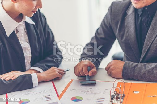 944422446istockphoto Business stamping rubber Stamp on a documents - business concept 954039438