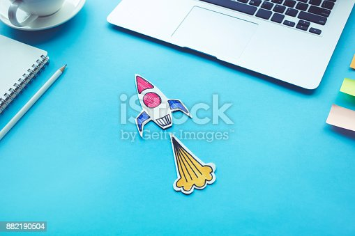 istock Business start up concept with rocket on desk table.Creativity innovation 882190504