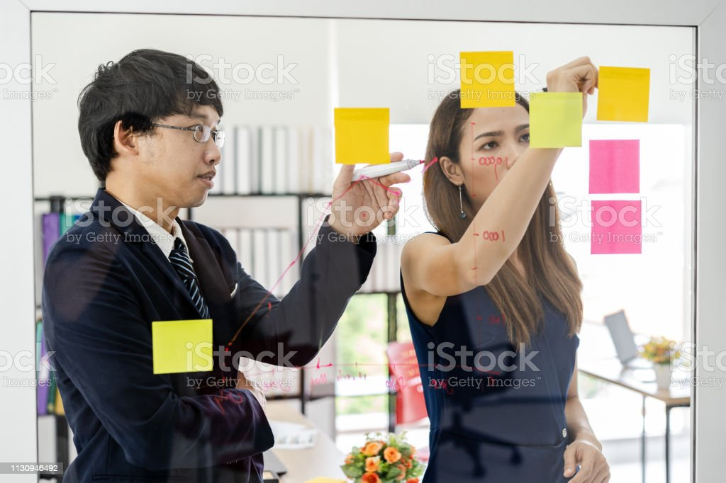 Business startup company meeting. Team leader discussing and...
