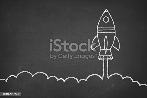 Business startup concept with space shuttle drawing on blackboard