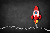 istock Business Startup Concept with Spaceship on Blackboard 1226797452