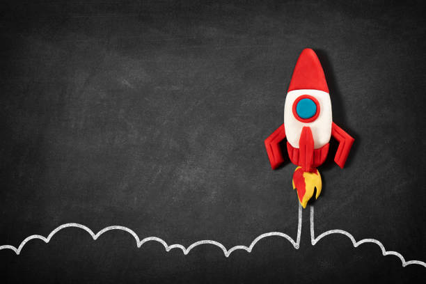 Business Startup Concept with Spaceship on Blackboard stock photo