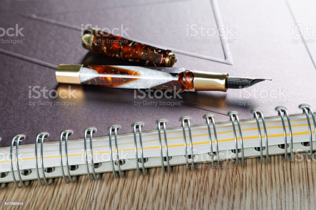 Business still life with a fountain pen and official papers stock photo