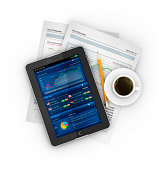 business stocks on tablet with coffee