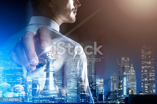 istock business strategy brainstorm chess board game with hand touch black background with free copy space for your text 1214654512