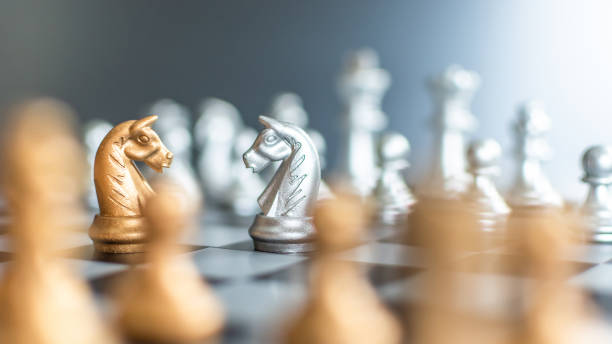 Business strategy competition, strategic planning for winning success and human resource management concept with chess figure knight leader on chessboard facing defender on opposite side Business strategy competition, strategic planning for winning success and human resource management concept with chess figure knight leader on chessboard facing defender on opposite side shock tactics stock pictures, royalty-free photos & images