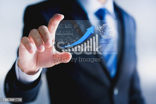 1051659174 istock photo Business strategy, Data analysis technology and financial growth concepts. Businessman hold virtual screen, analyze stock market reports and financial dashboards. 1262691725