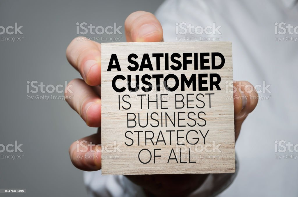 Business strategy A Satisfied Customer Is The Best Business Strategy of All Adult Stock Photo