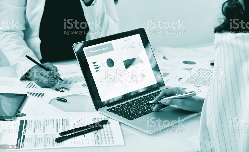 Business strategy planning, Business women discuss and review data documents, Business chart and graph analyzing. stock photo