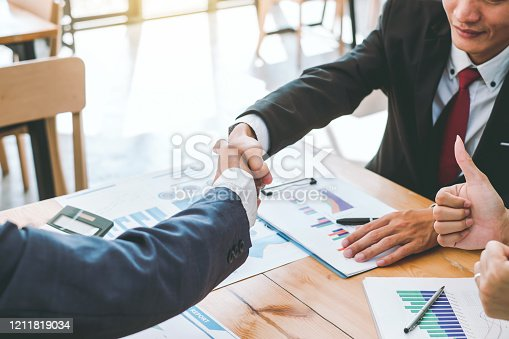541976840 istock photo Business success. Business people shaking hands in the meeting. Negotiating business. 1211819034