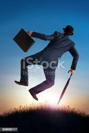 business success concept businessman kicking heels in the air