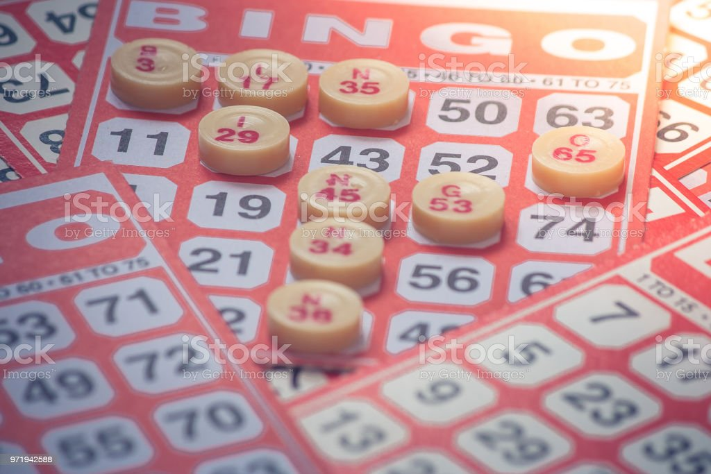 Business Success Concept : Red bingo card with red chip isolated on white background. stock photo