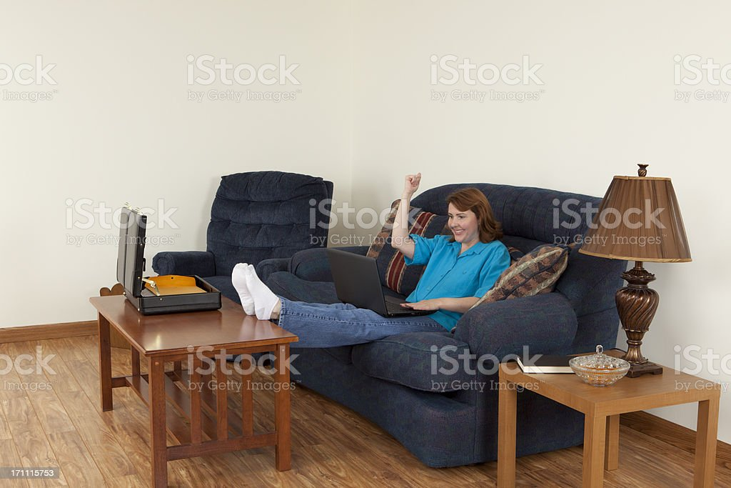 Business Success: Woman Working at Home on Laptop stock photo