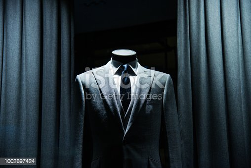 business suit store window display.