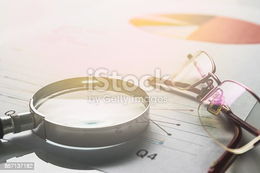 istock Business summary reports and a magnifying glass with glasses  on table office. Concept of Data Analysis, Investment Planning, Business Analytics. 857137182
