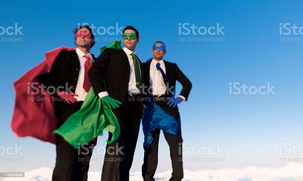 Business Superheros on a mountain peak royalty-free stock photo