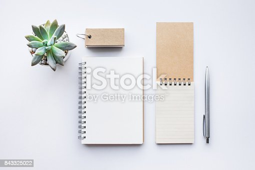843814242 istock photo Business table top with mock up office supplies on white 843325022