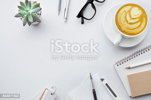 843814242 istock photo Business table top with mock up office supplies on white 843371502
