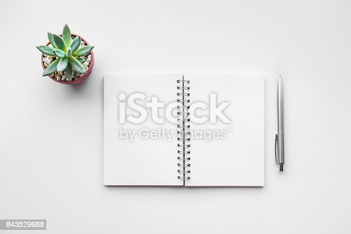 istock Business table top with mock up office supplies on white 843529688