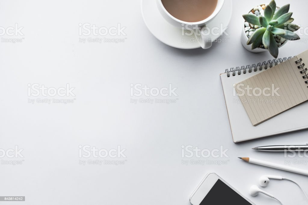 Business table top with mock up office supplies on white