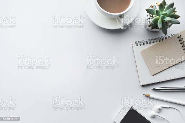 Photo of Business table top with mock up office supplies on white