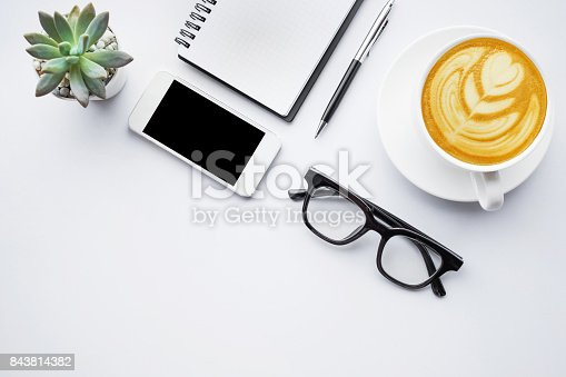 843814242 istock photo Business table top with mock up office supplies on white 843814382