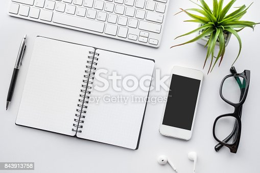 istock Business table top with mock up office supplies on white 843913758