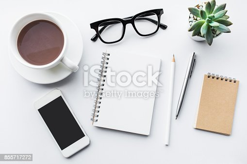 istock Business table top with mock up office supplies on white 855717272