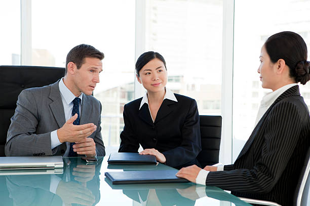 business talks with chinese businesswomen - translator stock photos and pictures
