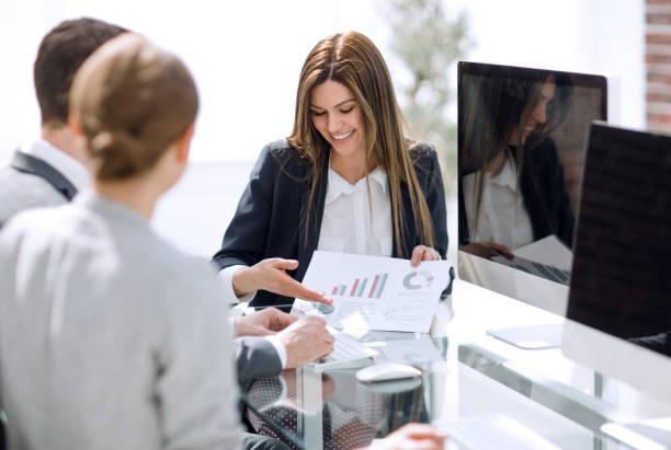 business team analyzing financial performance stock photo