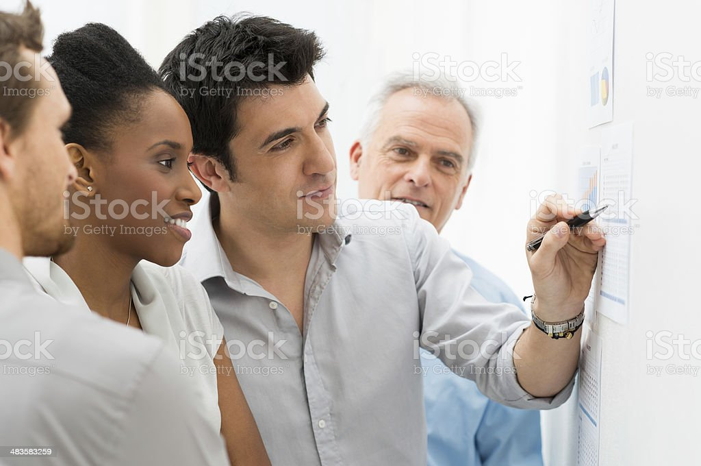 Business Team Analyzing Graph royalty-free stock photo