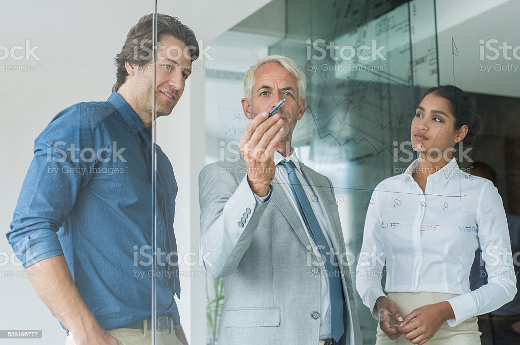 Business team analyzing graph stock photo
