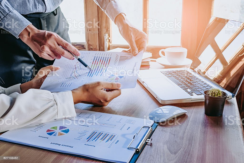 Business team analyzing income charts and graphs stock photo