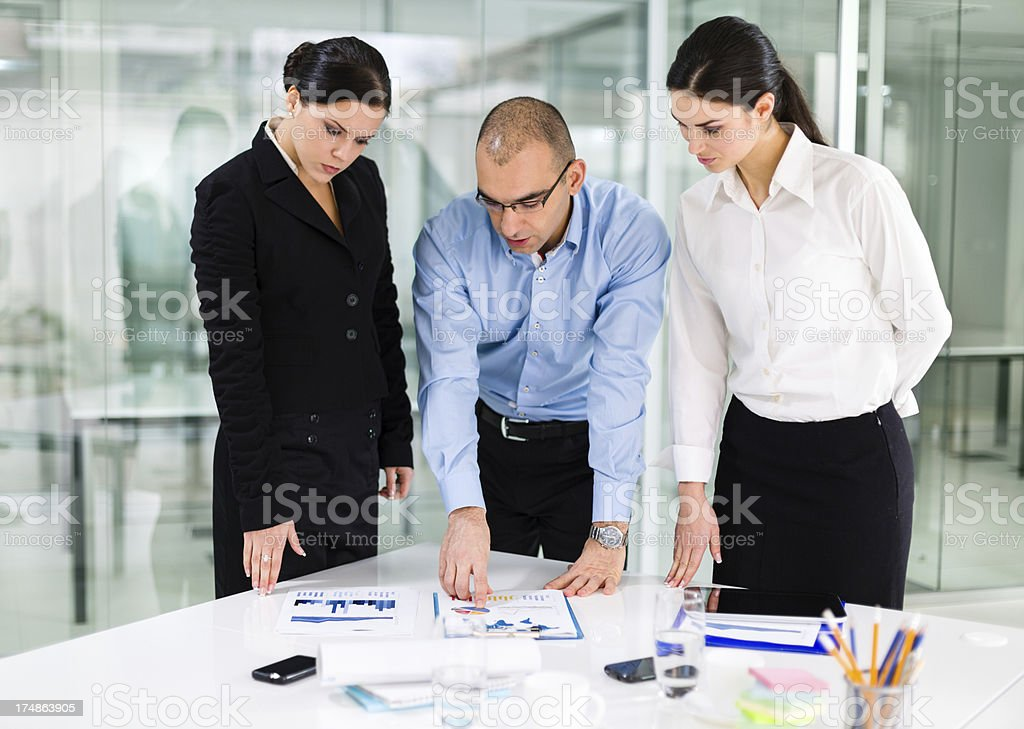 Business team analyzing reports royalty-free stock photo