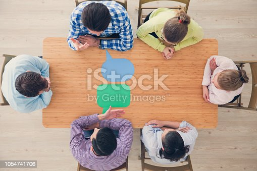 istock Business team and dialog boxes 1054741706