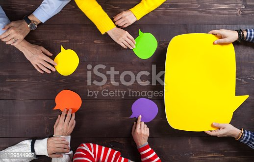 812513444 istock photo Business team and speech bubbles 1129844962